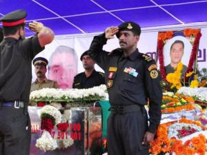 NSG commandos pay homage to the mortal remains of Lt Col Niranjan Kumar