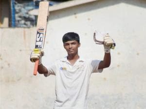 Pranav Dhanavade celebrates after creating a world record by scoring 1009 runs