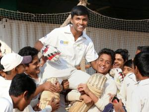 Pranav Dhanavade is lifted by his friends as thay celebrate