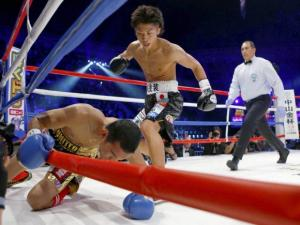 Champion Naoya Inoue, of Japan hits to challenger Warlito Parrenas
