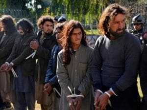 Taliban fighters are handcuffed by Afghan security forces