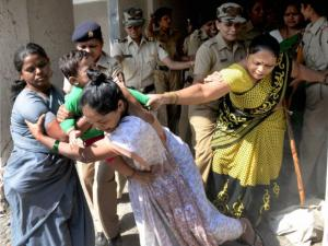 Women residents jostle with the police during a demolition drive in Ghansoli in Navi Mumbai