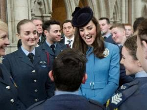 Britain's Kate, the Duchess of Cambridge, centre, reacts, as she attends a reception to mark the 75th anniversary year of the RAF Air Cadets, in London,