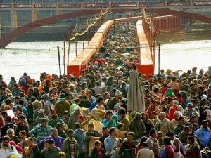 Devotees gather to take holy dip at Har ki Pauri on the occasion of Somvati Amavasaya in Haridwar on Monday