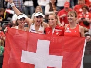Martina Hingis, Belinda Bencic, Viktorija Golubic, Timea Bacsinszky, from left to right, of Switzerland, celebrate after winning the Fed Cup World Group first round tenn