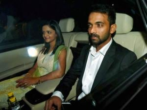Ajinkya Rehane with his wife arrives to attend  wedding reception of Harbhajan Singh