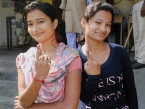 First time voters show their inked finger after casting votes