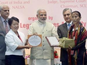 Prime Minister Narendra Modi felicitating the best district legal service authority