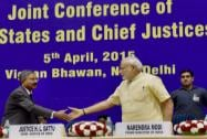 Prime Minister Narendra Modi shakes hand with Chief Justice of India H L Dattu