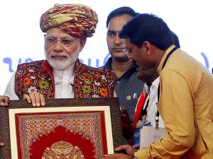 Narendra Modi being presented a portrait during inauguration of Tapper pumping station