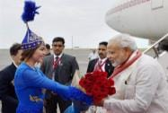 Prime Minister Narendra Modi being presented a bouquet by a Kazakhstani girl