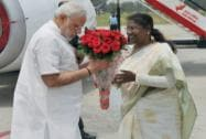 Prime Minister Narendra Modi is welcomed by the Governor of Jharkhand Draupadi Murmu