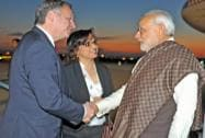 Prime Minister Narendra Modi being greeted by French Sports minister Thierry Braillard