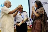 Prime Minister Narendra Modi presents an award to CBDT chairperson Anita Kapur