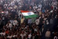Supporters wave an Indian flag as Prime Minister Narendra Modi