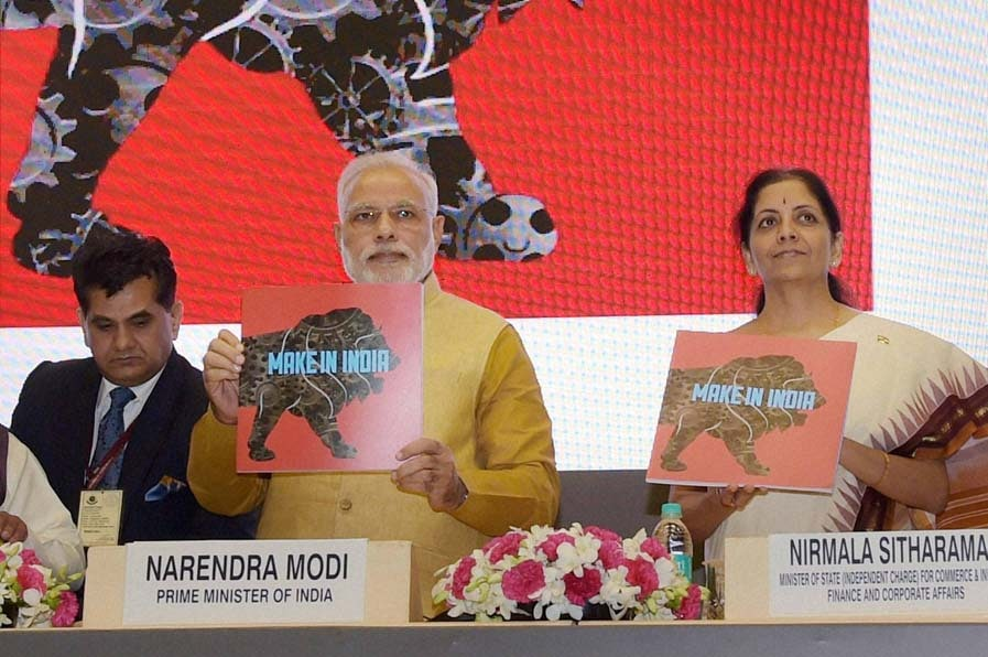 Prime Minister, Narendra Modi, MoS for Commerce, Industry Nirmala Sitharaman, launching, logo, Make in India Mission