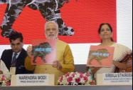 "Prime Minister Narendra Modi with MoS for Commerce and Industry Nirmala Sitharaman launching the logo of ""Make in India Mission"""