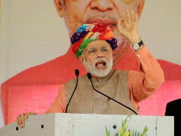 Narendra Modi,  Soil Health Card, Rajasthan Governor,  Kalyan Singh, Rajasthan Chief Minister,  Vasundhara Raje, Punjab CM,  Prakash Singh Badal