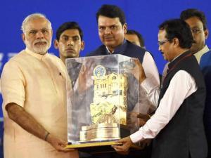 Prime Minister Narendra Modi felicitated by Maharashtra CM Devendra Fadnavis and BJP leaders