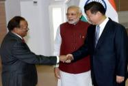 Chinese President Xi Jinping shakes hands with NSA Ajit Doval