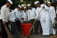 Dabbawalas takes part in a cleanliness drive as part of Swachh Bharat Abhiyan