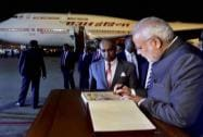 Prime Minister Narendra Modi writes in the visitors book upon