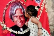 A child kisses former President APJ Abdul Kalam