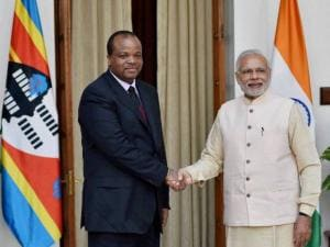 Prime Minister Narendera Modi shakes hands with Swaziland's King Mswati