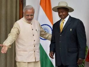 Prime Minister Narendra Modi shakes hands with Uganda President Yoweri Museveni at Hyderabad house in New Delhi