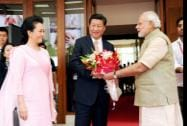 Prime Minister Narendra Modi greets Chinese President Xi Jinping upon his arrival at a hotel in Ahmadabad