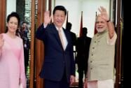 Prime Minister Narendra Modi waves along with Chinese President Xi Jinping and his wife Peng Liyuan at a hotel