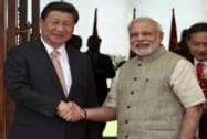Prime Minister Narendra Modi welcomes Chinese President Xi Jinping upon his arrival at a hotel in Ahmadabad