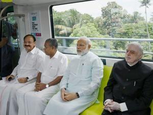 Prime Minister Narendra Modi with CM Pinarayi Vijayan take a ride