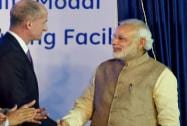 Prime Minister Narendra Modi and John Rice, Vice Chairman of GE shake hands at the inauguration of General Electric's