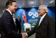 Prime Minister Narendra Modi shakes hands with UK Prime Minister David Cameron