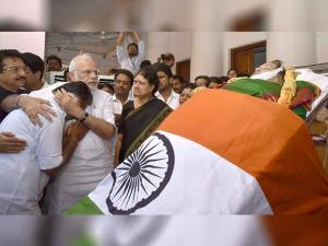 Prime Minister Narendra Modi consoles O Panneerselvam while pays his last respects to Tamil Nadu's former Chief Minister Jayaram Jayalalithaa