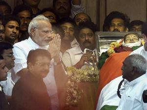 Prime Minister Narendra Modi greets supporters of Tamil Nadu's former Chief Minister