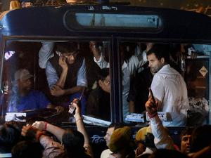 Congress party Vice President Rahul Gandhi being carried in a police bus from Parliament Street Police Station