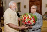 Narendra Modi presents a bouquet to President Pranab Mukherjee