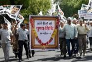 AAP workers shout slogans at a protest on the first anniversary of the Narendra Modi government