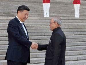 President Pranab Mukherjee is greeted by Chinese President Xi Jinping during his ceremonial welcome at Great Hall of the People in Beijing