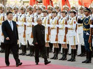President Pranab Mukherjee with Chinese President Xi Jinping inspects a guard of honour during his ceremonial welcome at Great Hall of the People in Beijing