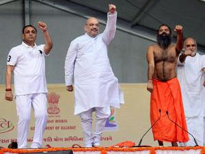 Amit Shah with Yoga guru Baba Ramdev perform Yoga