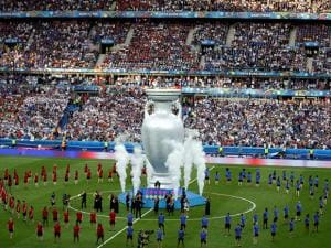Dancers perform around a giant trophy prior to the Euro 2016 final