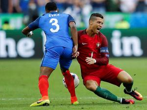 Patrice Evra and Cristiano Ronaldo during the Euro 2016 final