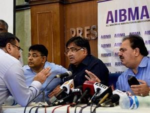 Ramesh Mago (c), President, All India Bread Manufacturers Association with other members during a press conference in New Delhi