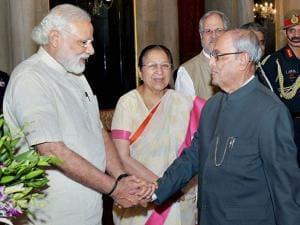 President Pranab Mukherjee shakes hands with Prime Minister Narendra Modi during the ceremonial departure to the State visit to China at Rashtrapati Bhavan