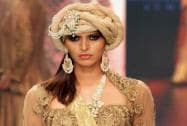 A model displays a creation during India International Jewellery Week 2015