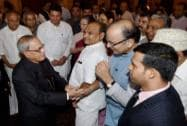 President Pranab Mukherjee shakes hands with Finance Minister Arun Jaitley