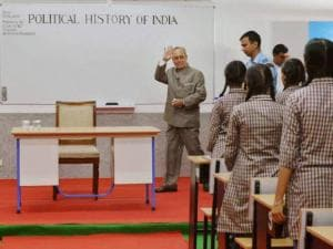 President Pranab Mukherjee arrives to teach students at a Government School